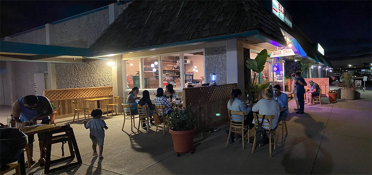 image shows guests enjoying eating on Baan Thai Patio