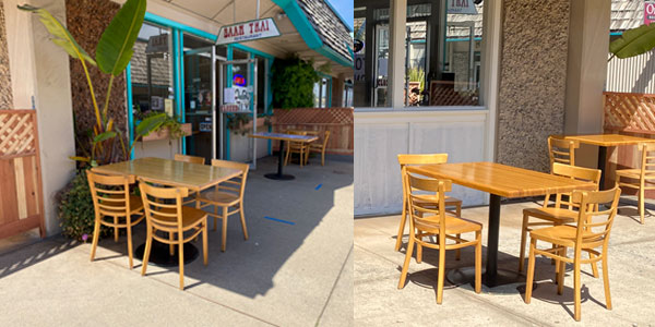 image shows tables outside restaurant