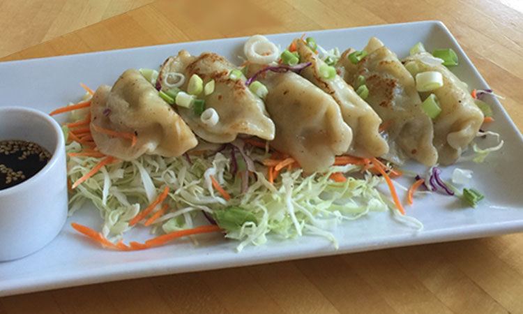 Potstickers: Chicken and vegetables perfectly seasoned in delicate wrappers.